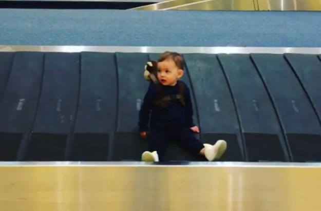 Adam Thomas' son Teddy on baggage carousel