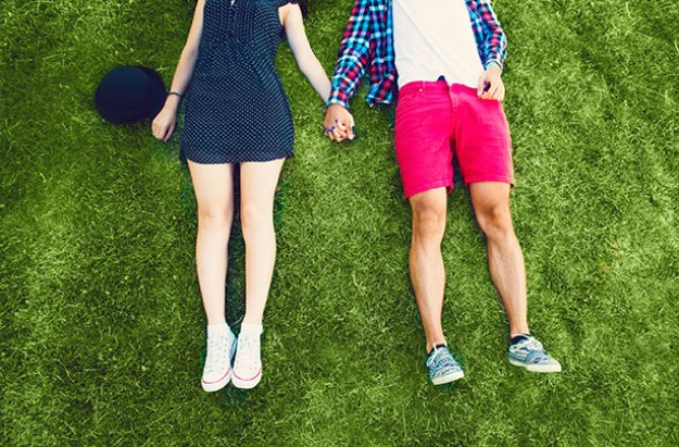 Couple lying on grass, outdoors, relationship, cheating, boyfriend, girlfriend