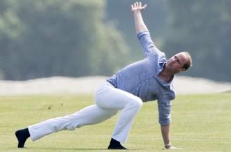 Prince William stretching, yoga