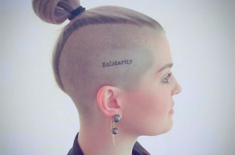 Kelly Osbourne gets 'solidarity' tattoo