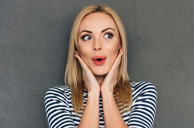 Blonde woman pulling a face, most and least attractive