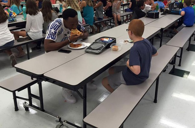 Leah Paske, footballer eats lunch with autistic son