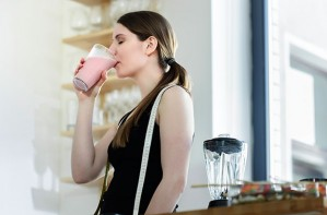 SlimFast, woman drinking meal replacement milkshake, diet