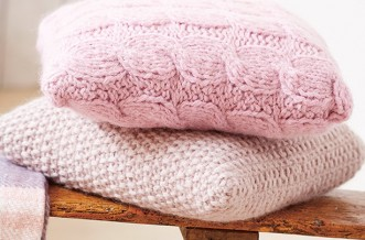 Free knitting patterns UK: Knitted cable and moss-stitch cushion covers