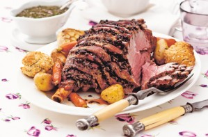 Herb-roasted leg of lamb with mustard dumplings