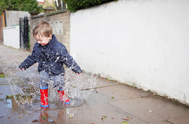 Activities for toddlers, boy jumping in puddles
