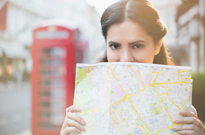 Woman holding a map, most adulterous towns