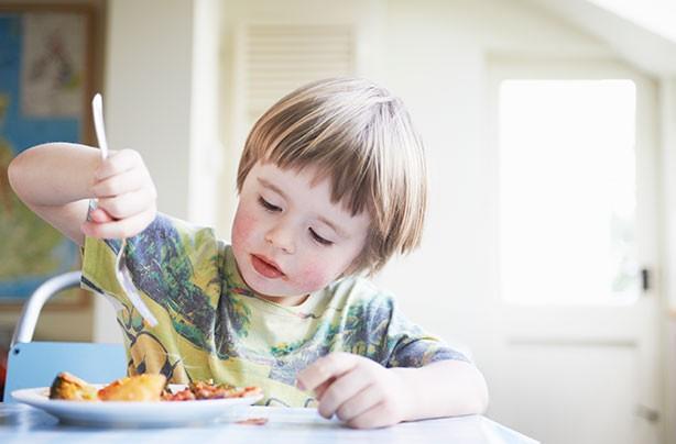 Sugar in kids foods, boy eating dinner