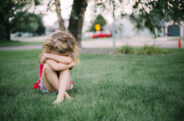 Sad young girl, child, signs of sexual abuse
