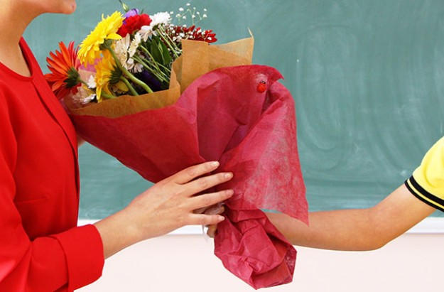 Teacher being given flowers