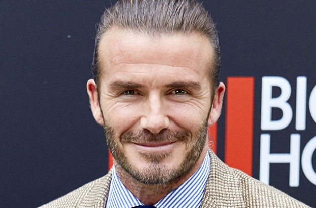David Beckham defends lip kiss with daughter