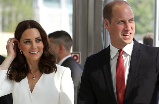 His royal shyness: George sticks out his lip as duty calls