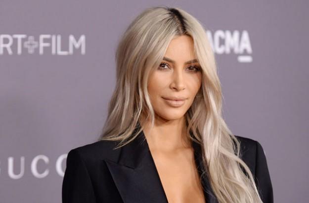 Kim Kardashian says using a surrogate is 'hard'