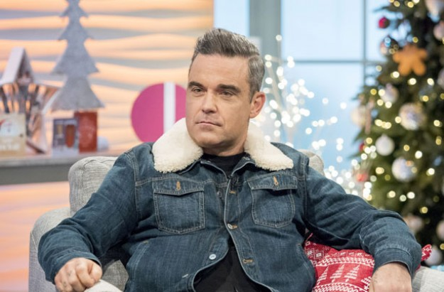 Robbie Williams sent to intensive care after doctors discovered brain 'abnormalities'