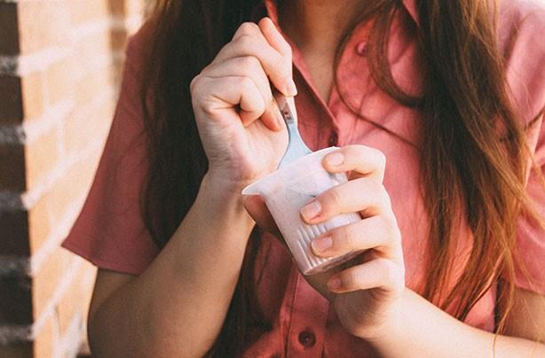 Woman eating healthy yogurt