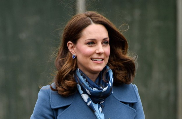 Kate Middleton bundles up baby bump for London outing