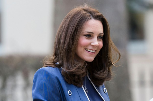 Pregnant Kate Middleton Looks Lovely in White at Charity Visit