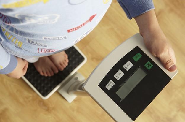 little boy on scales.