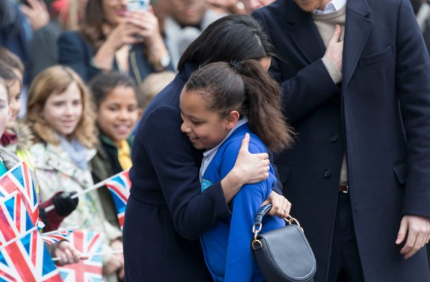 Meghan Markle hugs school girl in Birmingham