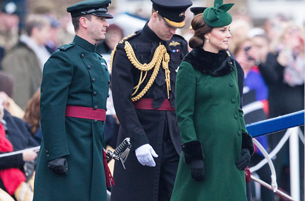 Catherine glows in green as William reveals she's due 'any minute now'